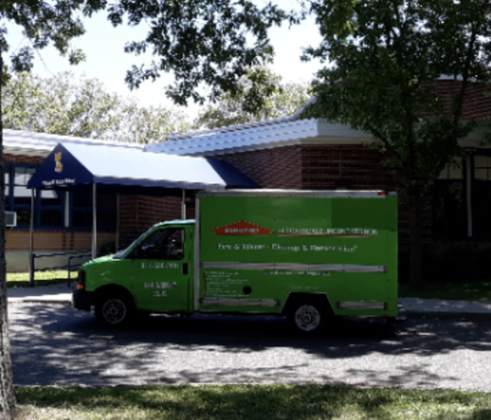 SERVPRO truck parked outside home.