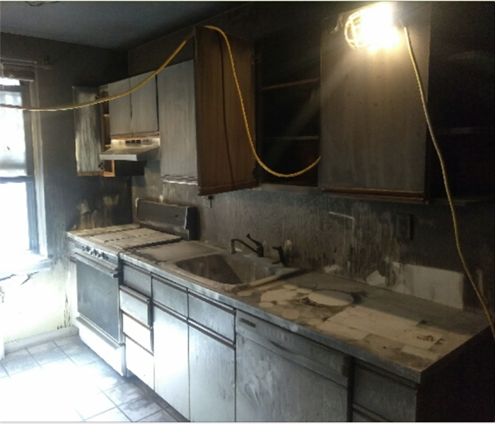 Fire damaged kitchen.