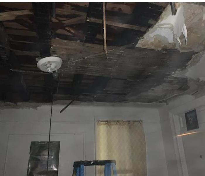 Fire damaged ceiling and walls.