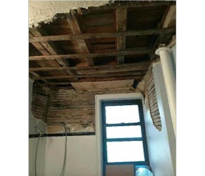 Ceiling and bathroom wall removed due to mold growth