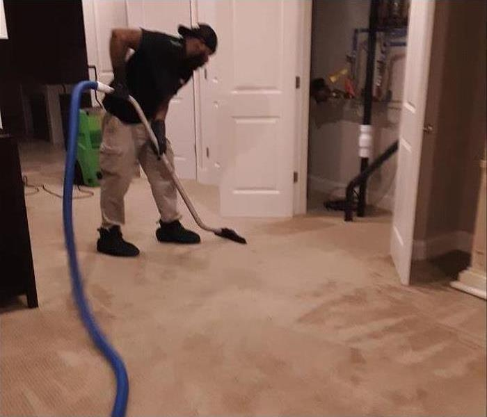 Professional extracting water with vacuum
