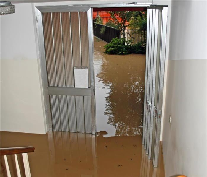 Floodwaters in the entrance of a home